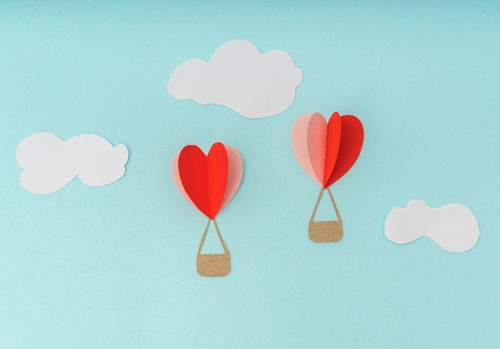 Paper cut of Heart Hot air balloons for Valentine's Day celebration .